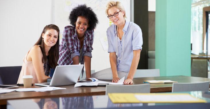 Portrait Of Businesswomen Having Creative Meeting In Office